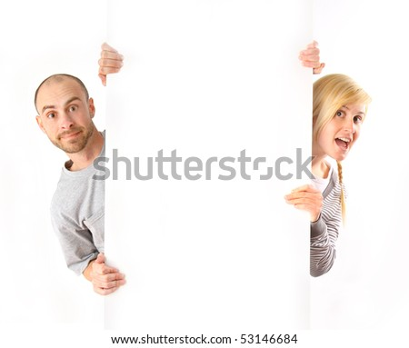 Man and woman holding empty white board