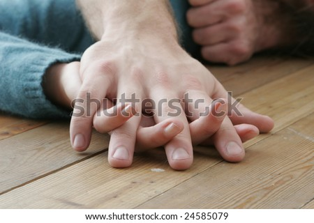 Man and woman holding hands together, close up
