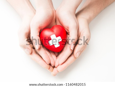 Man and woman holding red heart in hands isolated #1160482015