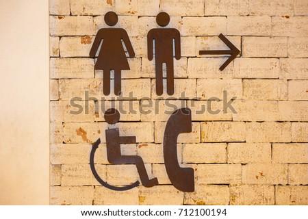 Man and Woman icon , Arrow icon , Toilet sign , Wheelchair icon ,Telephone icon #712100194