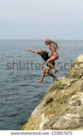 man and woman in a jump