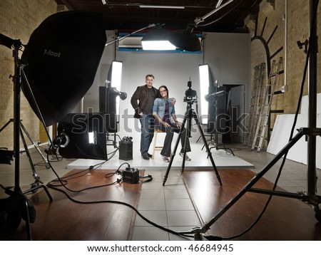 Stock Photo man and woman in a modern photo studio