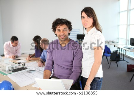 Man and woman in front of a business laptop