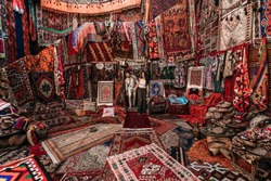 Man and woman in the store. Couple in love in Turkey. Man and woman in the Eastern country. Gift shop. A couple in love travels. Persian shop. Tourists in store. Oriental carpet. Istanbul. Cappadocia