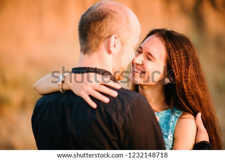 Man and woman look at each other #1232148718