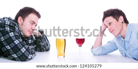 man and woman looking at a pint of beer and glass of wine on table with white background