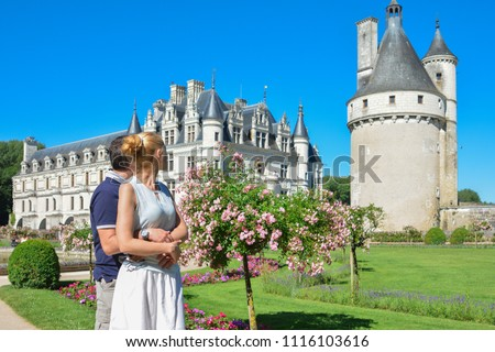 Man and woman looking at the castle Chenonceau Medieval Chateau in France #1116103616