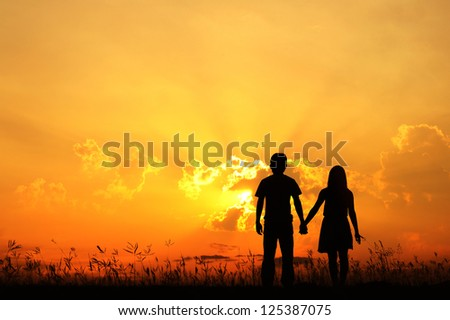 Man and Woman love silhouette in sunset