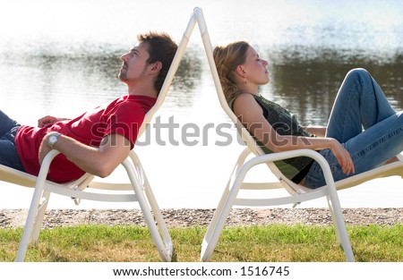 Man and woman lying back to back.