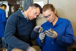 man and woman mechanics atwork