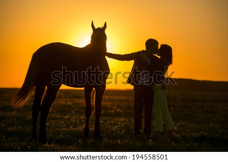 man and woman near a horse