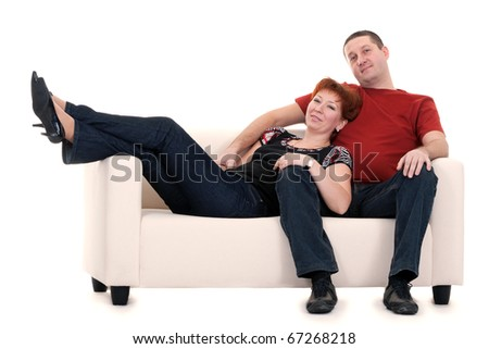 Man and woman on a sofa on a white background