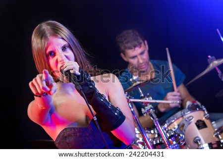Man and Woman Playing and Singing Rock Music