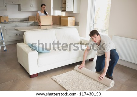 Man and woman relocating and furnishing their new house