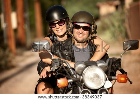 Man and Woman riding on vintage motorcycle