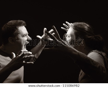Man and woman screaming at each other. Marriage before the divorce. OTHER PHOTOS FROM THIS SERIES IN MY PORTFOLIO.