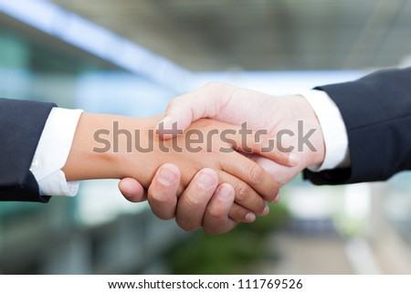 Man and woman shaking hands at the office