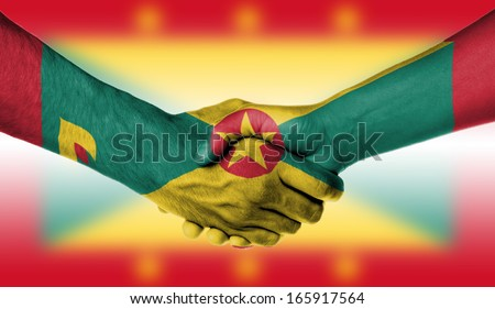 Man and woman shaking hands, wrapped in flag pattern, Grenada #165917564