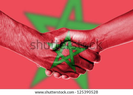 Man and woman shaking hands, wrapped in flag pattern, Morocco