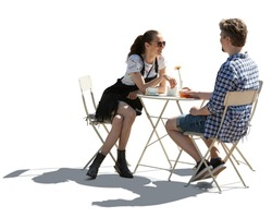 Man and woman sitting in a street cafe and talking, backlit image isolated on white background