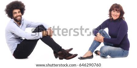 Man and woman sitting in front of a white background