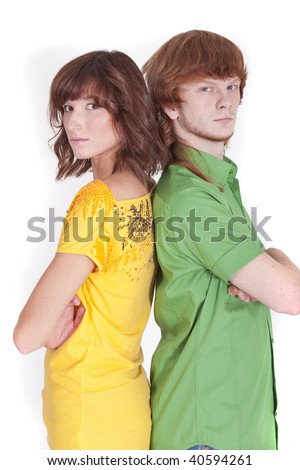 man and woman standing back on back - stock photo