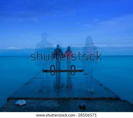 man and woman standing on the concrete pier
