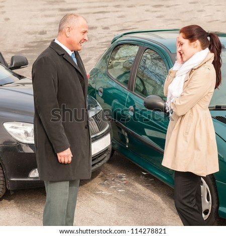 Man and woman talking after car crash sad guilt problem