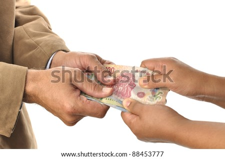 Man and woman tugging money from each other on white background