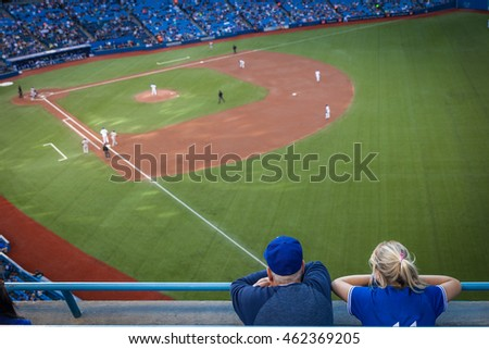 Man and woman watching a baseball game on the opening pitch stock photo