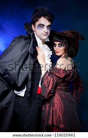 man and woman  wearing  as  vampire and  pregnant witch. Halloween