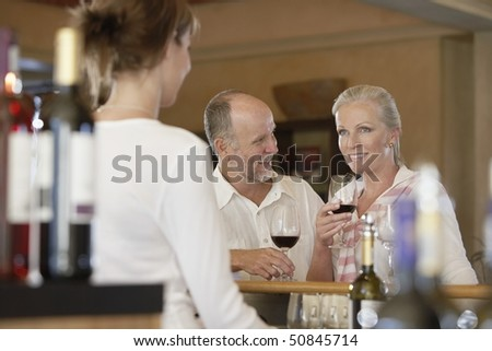 Man and woman wine-tasting, selective focus