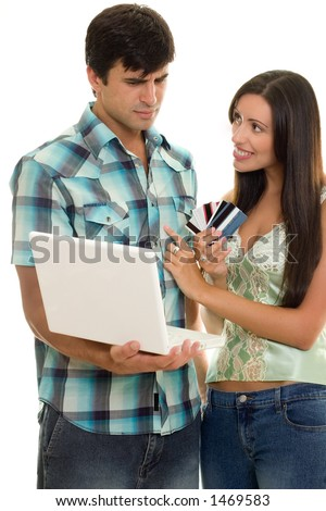 Man and woman with laptop and credit cards.    Online shopping, auctions, banking, finance, e-commerce, etc.