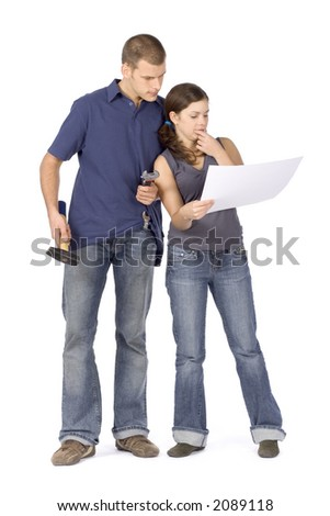 man and woman (workers) standing with tools and house plan