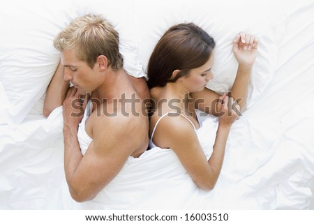 man and women in bed asleep