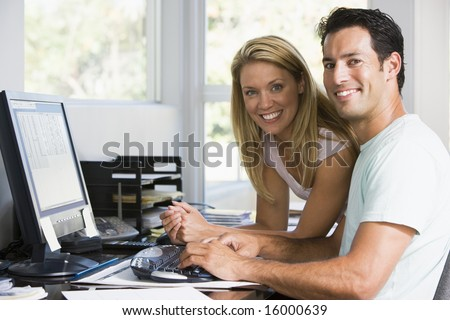 man and women on computer at home