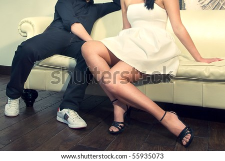 man and women relaxing on the sofa together