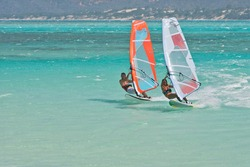 Man and women windsurfing in the lagoon