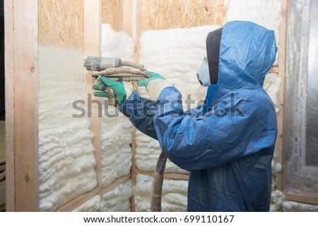 Man applies foam