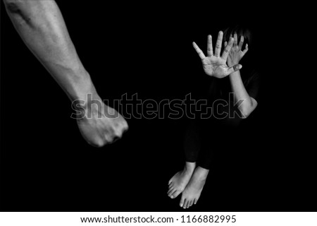 man are using force to coerce woman. scared woman lift hand up for say stop, to protect herself. stop domestic violence against women and anti human trafficking campaign.