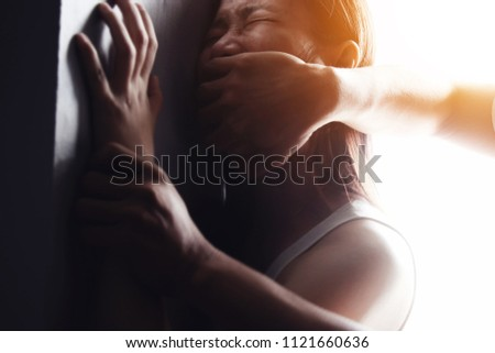 man are using force to coerce woman .stop domestic violence against women campaign.