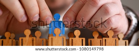 Man arm in suit take little plastic toy figure out of crowd closeup. Fire one worker hr job shift head hunter inspector rare disease unit dismissal retire lgbt media virus epidemic success concept