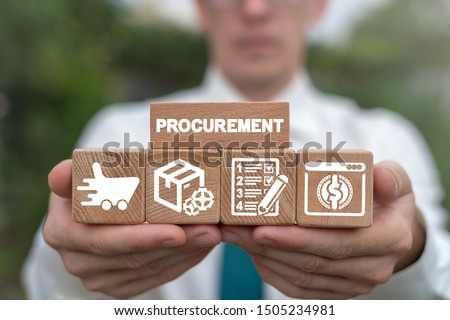 Man arranging wooden blocks with supply chain and retail logistics icons. Procurement Management Industry concept. Stockfoto ©