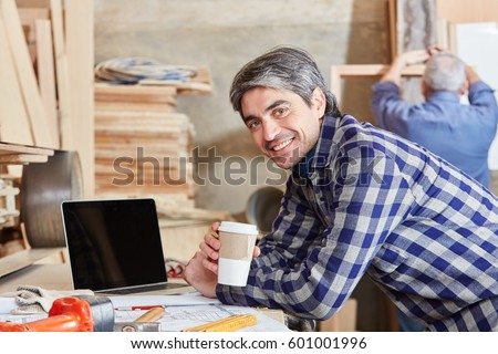 Man as carpenter taking a coffe break and relaxing #601001996