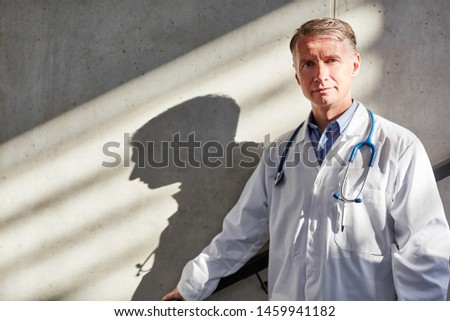 Man as senior physician or chief physician with competence and authority in the hospital