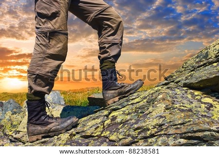 man ascending by a stones #88238581