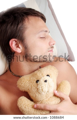 Man asleep with teddy bear