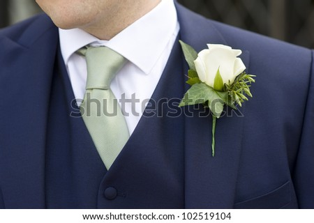 man at a wedding wearing a floral buttonhole