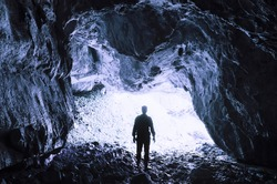 man at cave entrance