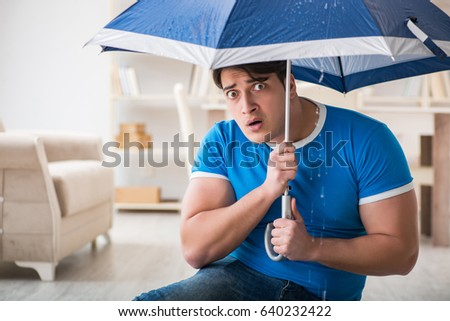 Man at home dealing with neighbor flood leak #640232422